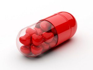 pill capsule with hearts inside