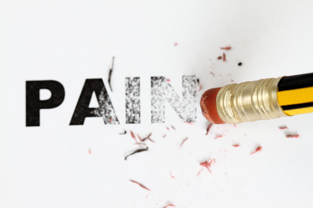 pencil rubbing out word pain