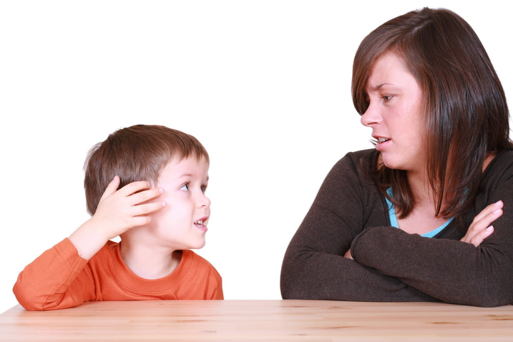 boy talking to woman