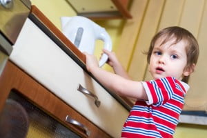 boy reaching for kettle