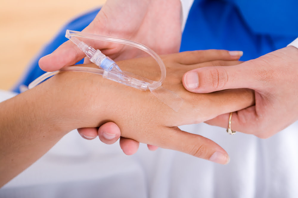 IV drip attached to woman's hand