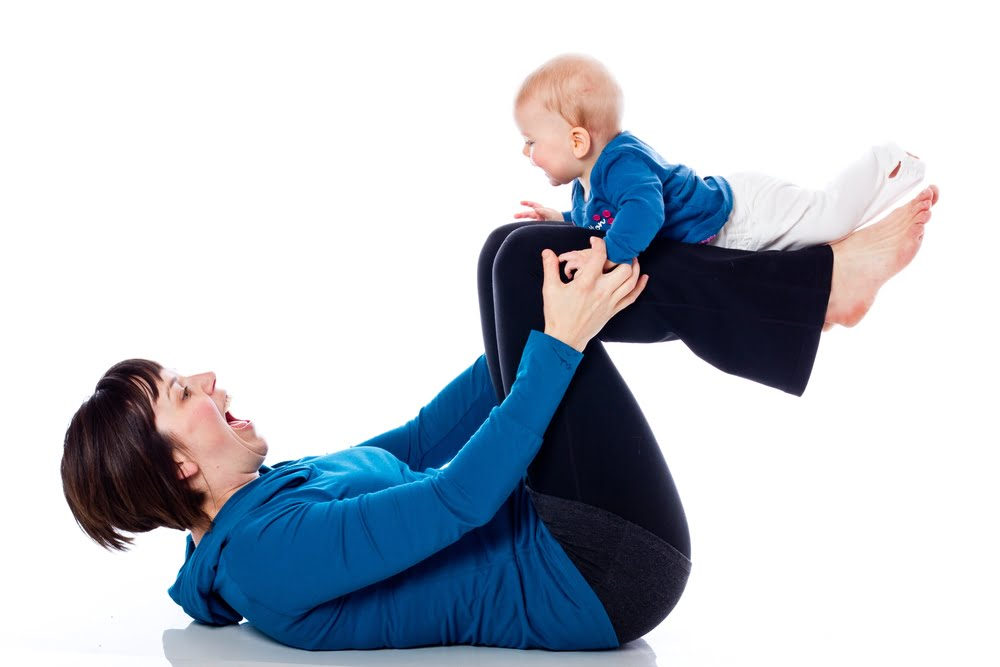 mum doing yoga with baby