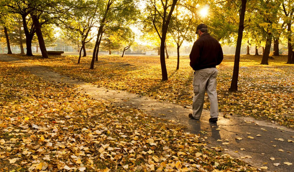 man walking in park