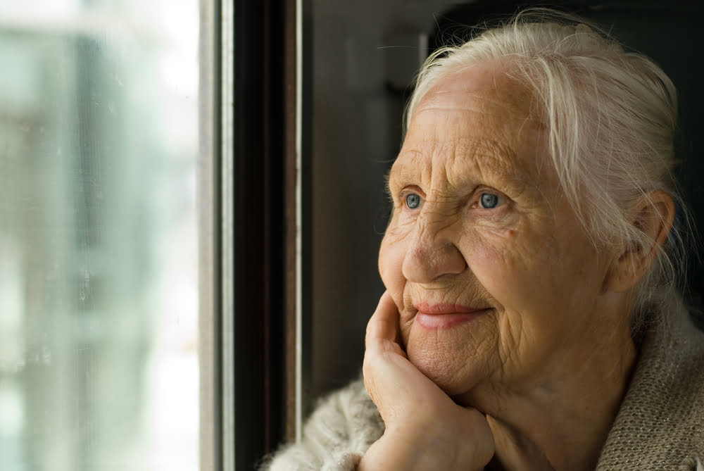 smiling woman at window