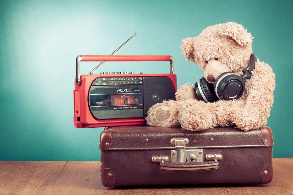 teddy with headphones, radio and suitcase