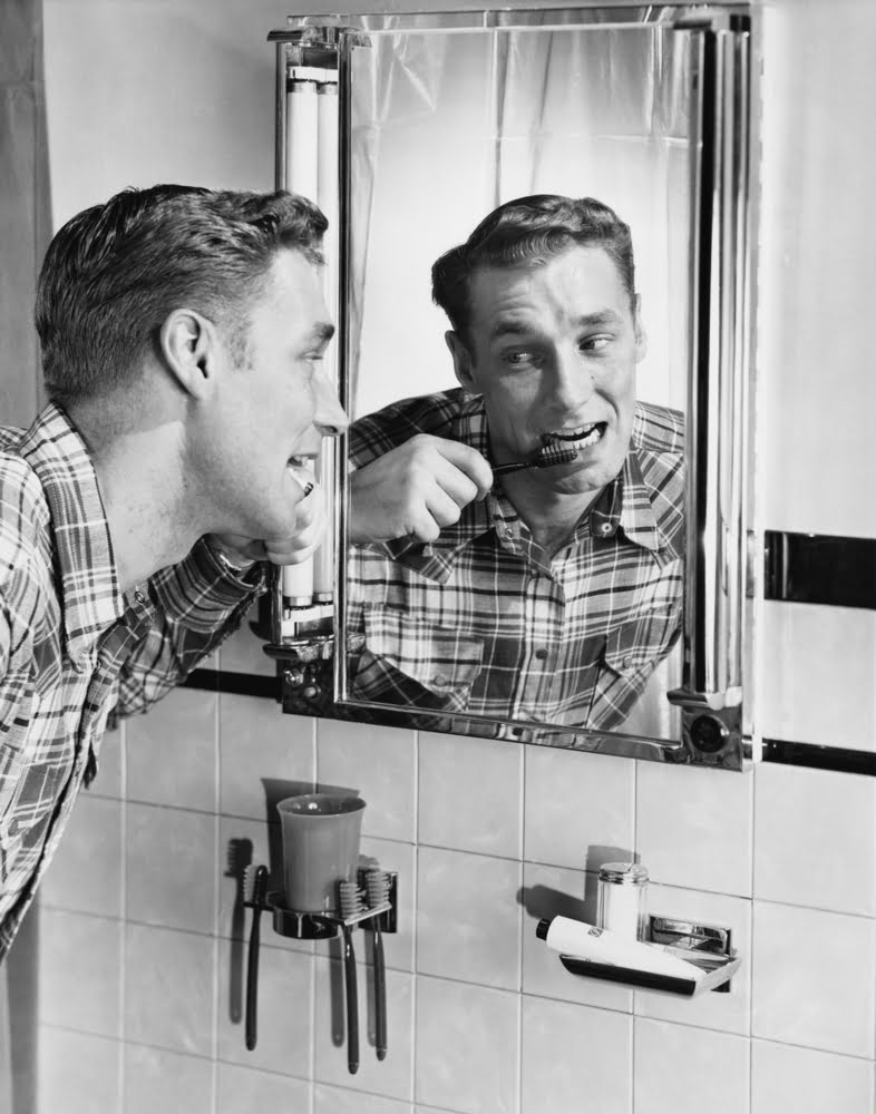man cleaning teeth