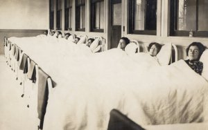 black & white photo of women in hospital beds