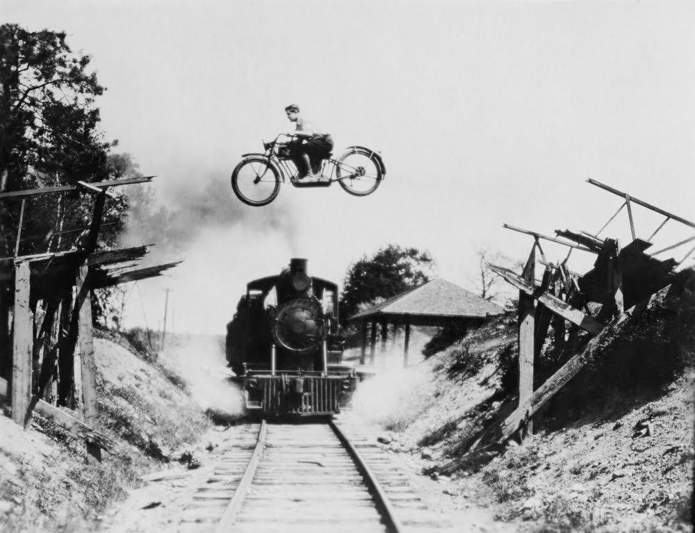 bike leaping over train