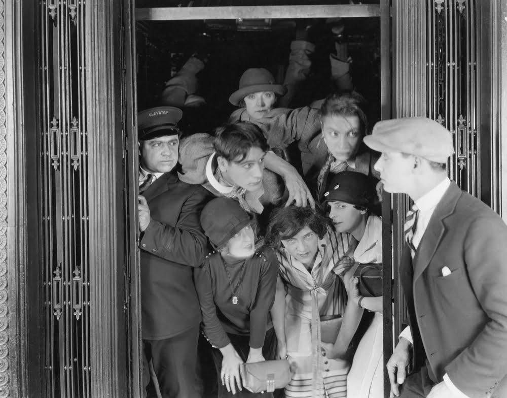 vintage photo of crowded elevator