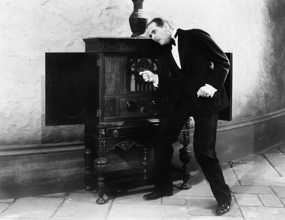 vintage photo of man listening to radio
