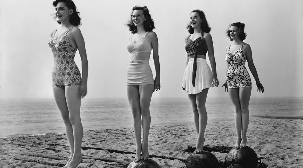 vintage women standing on beach