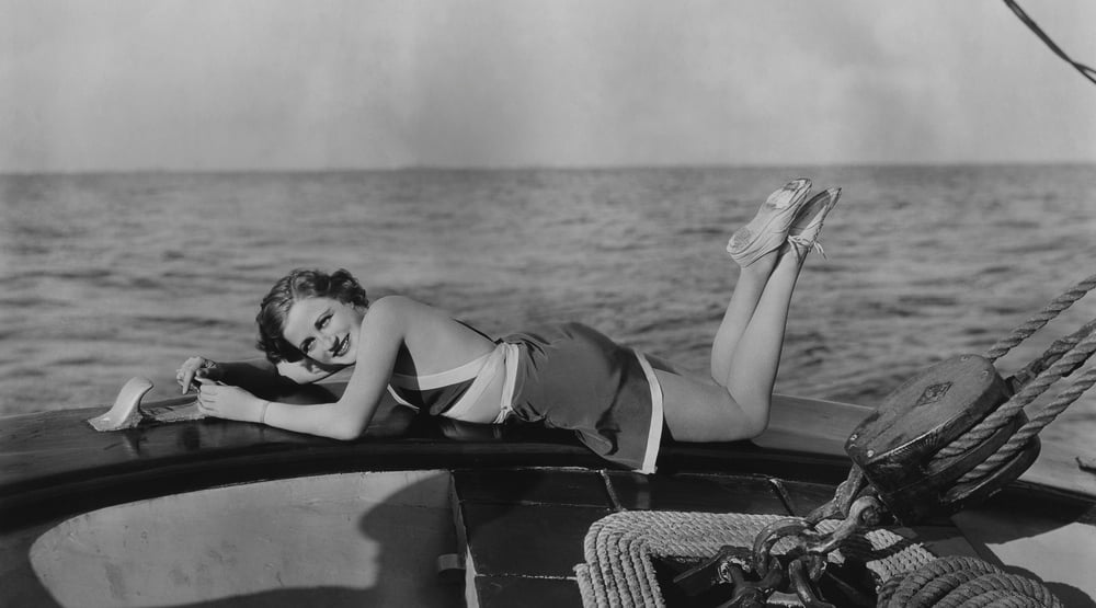 woman relaxing on yacht