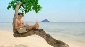 man with laptop on beach