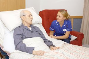 Nurse listening to an elderly patient