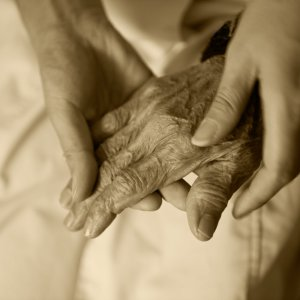 young hands holding old hand