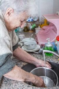 senior woman washing up