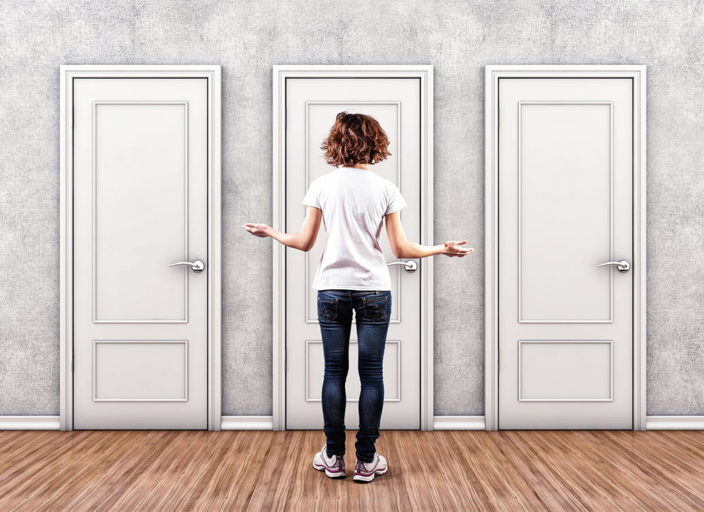 woman choosing which door to go through