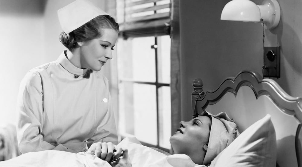 vintage nurse talking to patient