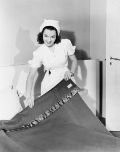 vintage nurse making bed