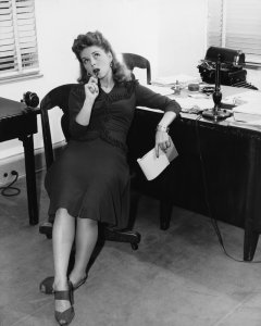 vintage female office worker thinking