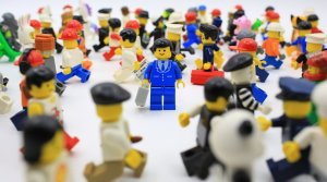 Lego figure in crowd of lego figures