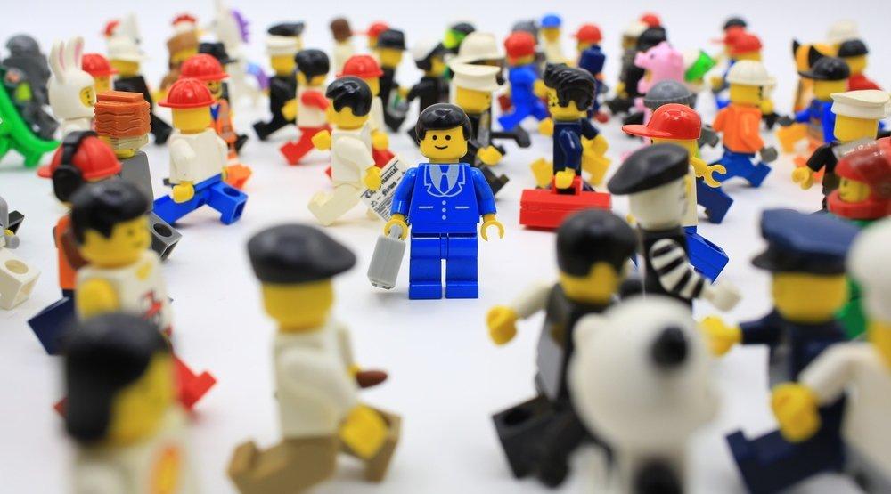 Lego figure in crowd of lego figures