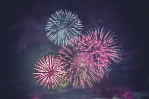 Fireworks display on dark sky background.
