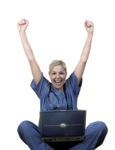 happy healthcare professional with laptop