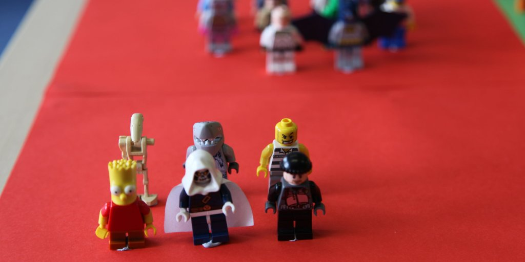 6 lego figures on red