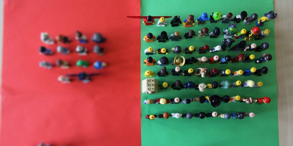 79 lego figures on green