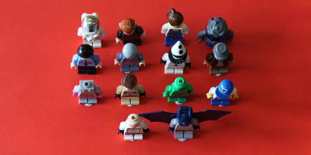 14 lego figures on red