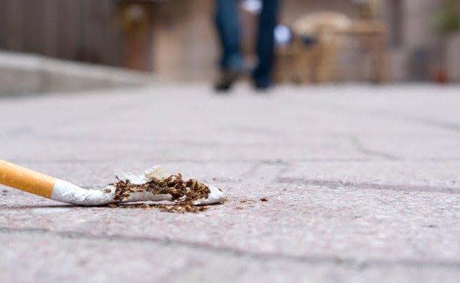 cigarette on pavement