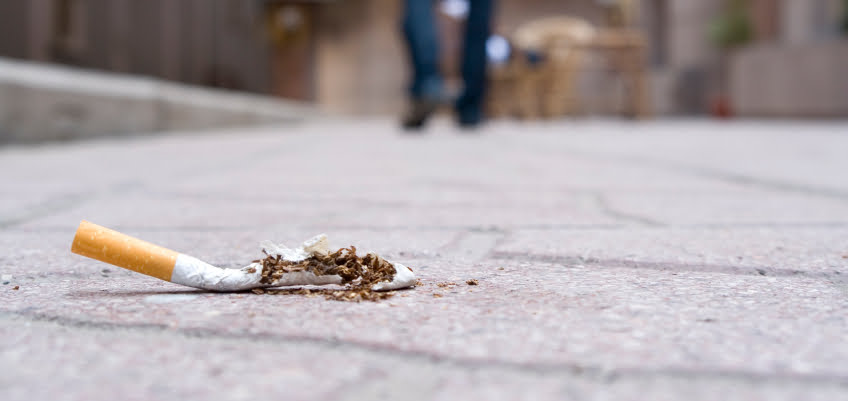 cigarette on pavement