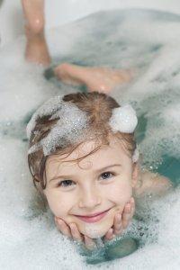 child in bubble bath