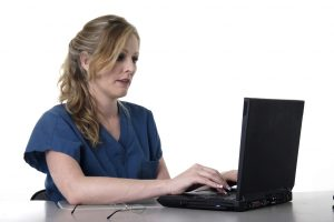 Healthcare worker using laptop