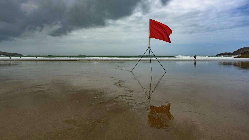 beach with a red flag warning
