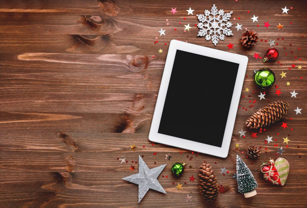 Christmas and New year background with tablet and decorations.