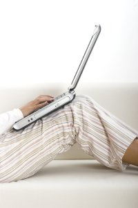Person in pyjamas with laptop