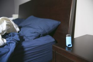 Asthma inhaler by the bed