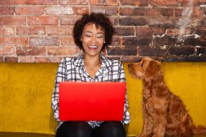 woman blogging with dog