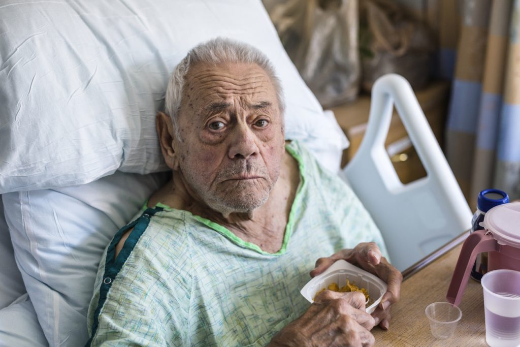 Elderly Man Hospital Patient Eating in bed
