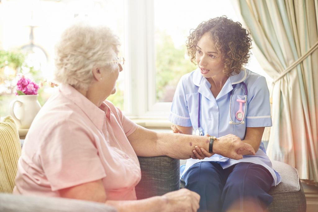 district nurse visit to senior woman