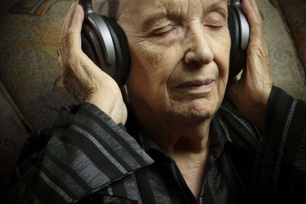 man listening to music through headphones
