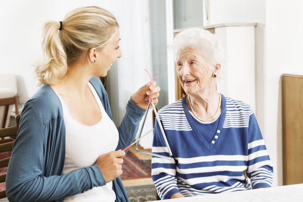 Alzheimer therapy senior woman musical instrument