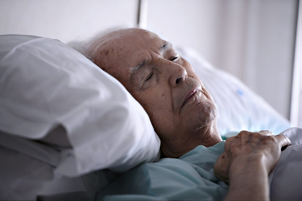 Senior man with dementia in bed