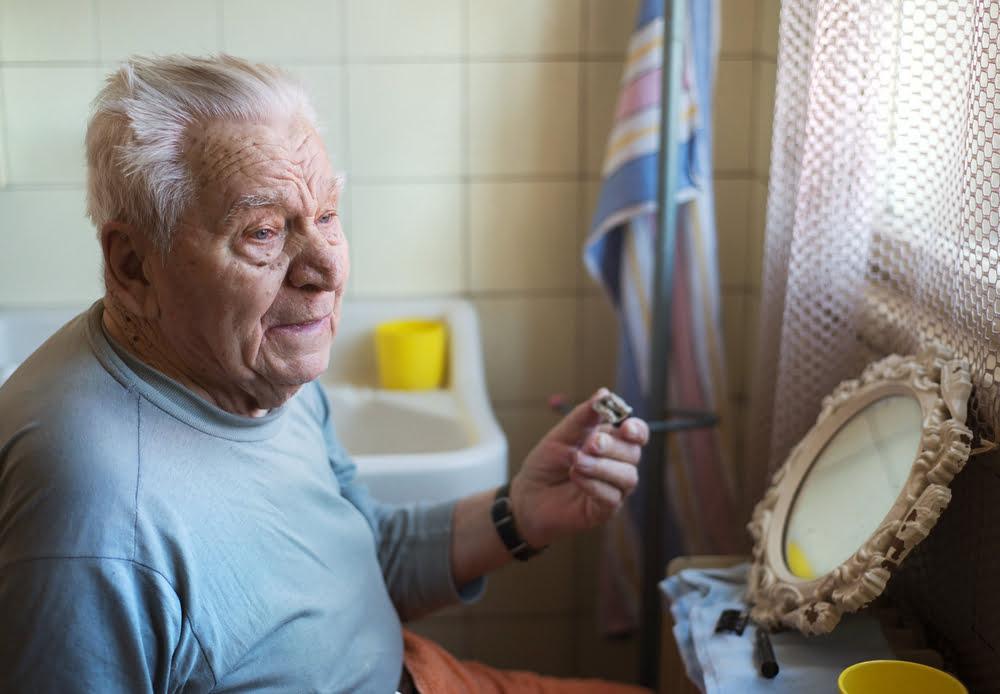 senior man shaving