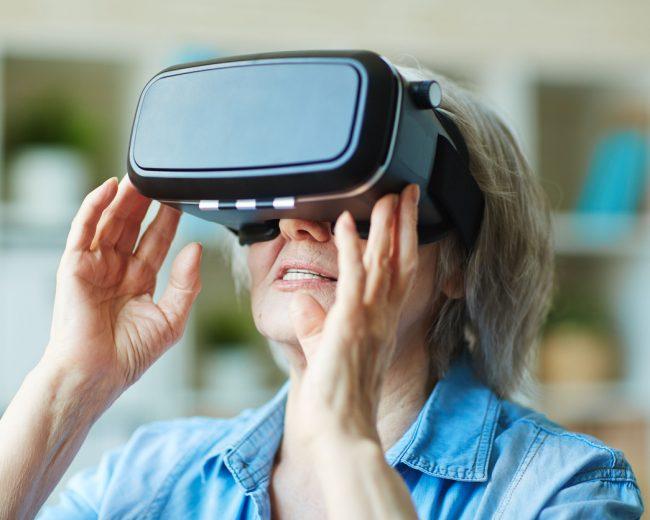 Senior female in virtual reality headset