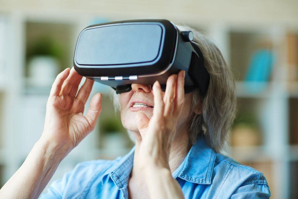 Senior female in virtual reality headset