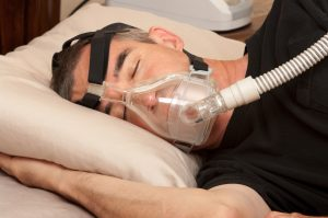 man with Sleep Apnoea and CPAP