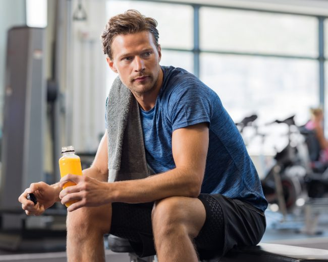 Fit man with energy drink